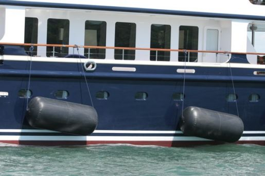 Inflatable fenders on side of boat